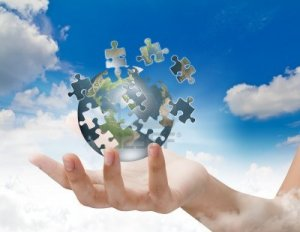 11425161-business-concept-with-a-hand-building-puzzle-globe[1]